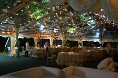 Clear roof wedding reception marquee at night. Looks amazing with festoon lighting!