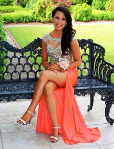 Kinsley Centers look amazing in her neon orange prom dress with sparkling sequin bodice. Love her Mac Duggal prom dress!