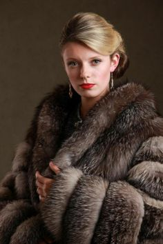gorgeous lady wearing a beautiful fox fur coat that compliments her skin tone love it