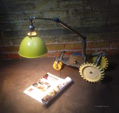 adjustable reading light made from an old lawn tractor. Created by Mark Bell.