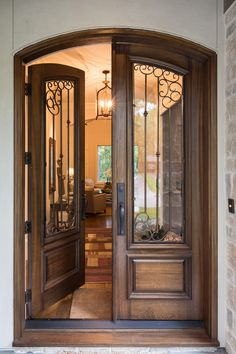 Designed by Diana Walker – Houston home designed with a combination of Texas, French and Southwest styles. Arched Front Door, Front Door Entryway, Iron Front Door, Wood Front Doors, Entry Doors, Wooden Doors, Door Gate Design, Wooden Door Design, Main Door Design