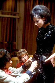 Mademoiselle Chanel fitting one of her most famous creations- the little black…