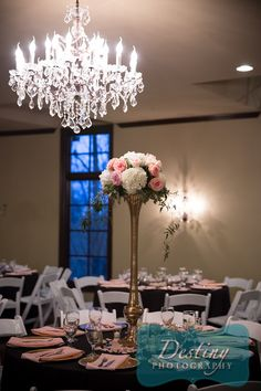 Beautiful centerpieces at Vesica Piscis Chapel in Catoosa, Oklahoma. The chandeliers look amazing! Photography by Destiny Photography