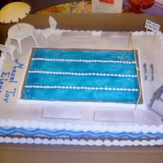 Cool swimming pool cake, thought it was real for a second there:)
