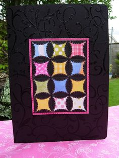 handmade quilt card ... Japanese folded patchwork ... luv how the colors get brighter on black backgrounds ...