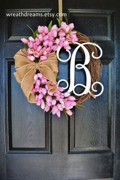 A beautiful & refreshing year-round wreath decorated with a Pink Mini Tulips complemented by a Pearl-accented natural burlap bow.  ❤ All wreaths are handcrafted by me using natural grapevine wreaths & only the highest quality faux materials.  ❤ Grapevine Wreath Specifications: • Choose from 18, 20, 24 or 26. • Please note that grapevine wreaths are natural products so measurements & shapes may vary slightly.  ❤ OPTIONAL Wood Monogram Specification: • Choose from 12 thru 20 availab...