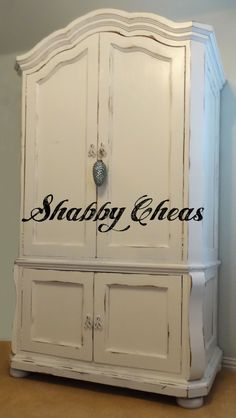 I love the distressing on this one! ARMOIRE PAINTED @ SHABBYCHEAS.COM