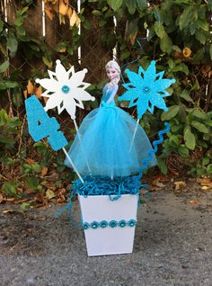 Disney Frozen Elsa Birthday CenterPiece!!!! Make this Centerpiece be the Fantastik Touch!! It can also be used for room decor. Please let us know the number(age) you want in the centerpiece in your order NOTES! Listing is for 1, single sided, centerpiece stands at approximately