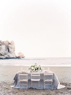 Photography: Sally Pinera - http://www.stylemepretty.com/portfolio/sally-pinera Styling: Kelly Oshiro Design - kellyoshirodesign.com   Read More on SMP: http://www.stylemepretty.com/2016/01/19/coastal-winter-white-wedding-inspiration/