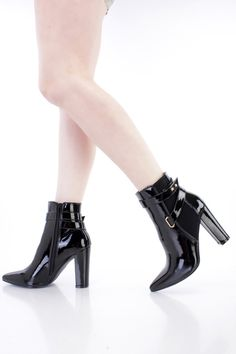 These sexy single sole chunky heel ankle booties are a must have! The features include a patent faux leather upper with a pointed closed toe, textured fabric side inset, strappy design, stitched trim, inner side zipper closure, smooth lining, and cushioned footbed. Approximately 4 inch heels.