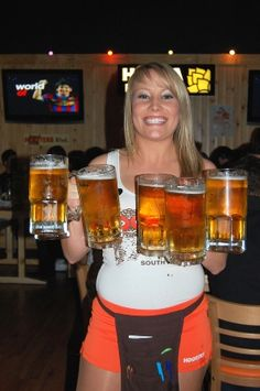 Head to Hooters and do it like the Americans do – with women and wings.