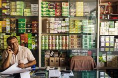A storekeeper speaks on the phone at a tea store in Siliguri, West Bengal, India, on Tuesday, Dec. 8. 2015. India has a $4.8 billion premium tea market, equivalent to 80 million kilograms of premium tea that can be exported out of the country. Photographer: Sanjit Das/Bloomberg via Getty Images