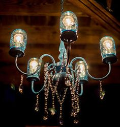 Rustic Wedding Mason Jar Chandelier - If we could find the guts to an old chandelier this would be beautiful!