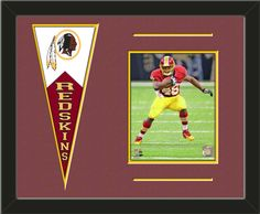 One framed 8 x 10 inch Washington Redskins photo of Alfred Morris with a Washington Redskins mini felt banner, double matted in team colors to 20 x 16 inches.  The lines show the bottom mat color.  (Pennant design subject to change)  $79.99 @ ArtandMore.com