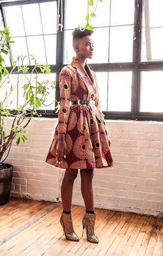 Semi-fitted waist w/ full skirt. Unlined wrap coat dress. Raglan long sleeves. Shawl collar. No closure (belt jacket to close)