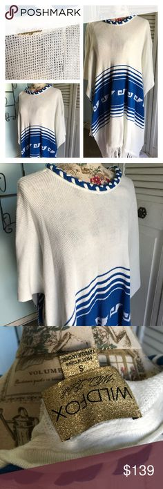 WILDFOX COUTURE White Label Frida Fringe Poncho WILDFOX Couture White Label Frida Traveler Fringe Poncho size Small. New with tags. Dry Clean Only. 60% Cotton / 40% Acrylic. Cream and blue fringe knit. Beautiful braided neckline. Style Staple piece that's timeless. Please let me know if you have any questions. 30% additional discount when bundling. Reasonable offers may be considered via offer button only. No trades. Wildfox Couture Sweaters Shrugs & Ponchos