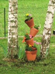 Building a stacked pot garden is as easy as 1, 2, 3
