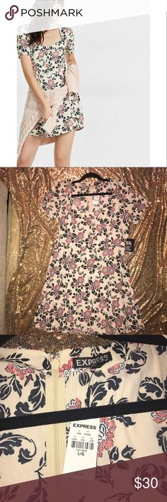 Express Ruched Front Dress Express Ruched Front Floral Short Sleeve Dress. New with tags. Size Large 💥💥No other discounts given. PRICE IS FIRM💥💥 Express Dresses Mini