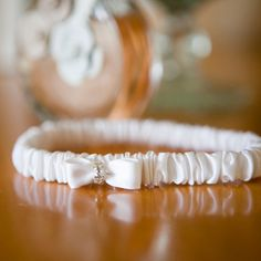 Even the wedding garter had a touch of bling at this luxe @Four Seasons Hotel Toronto wedding.