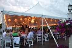 Garden reception on patio with paper lantern decorations.