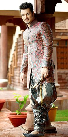 One of the majorly worn Wedding Sherwani nowadays is Jodhpuri Sherwani. Jodhpuri Sherwani is not only limited to Jodhpur but its famous all over the world. Mens Wedding Wear Indian, Mens Indian Wear, Indian Groom Wear, Indian Men Fashion, Arab Fashion, Male Fashion, Mens Sherwani, Wedding Sherwani, Ladies Sangeet