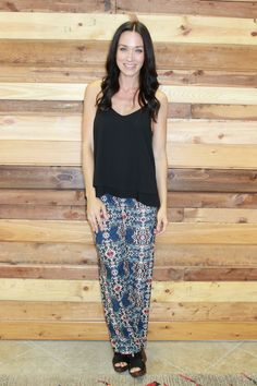 navy patterned palazzo pants paired with our basic black scalloped tank!