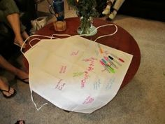 Have each guest sign our Pampered Bride apron for a cute shower souvenir.