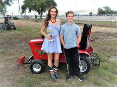 Lane Duncan presents Victoria Leigh with an honorary pulling trophy, after her National Anthem performance at the Hunt County Fair Tractor Pull in Greenville, Texas. Greenville Texas, Garden Tractor Pulling, Kids Ride On, County Fair, National Anthem, Tractors, Presents, Victoria, Mini