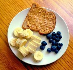 Pre-workout snack - one slice of whole wheat or Ezekiel toast w/ almond butter w/ half banana & blueberries #preworkout #motivation