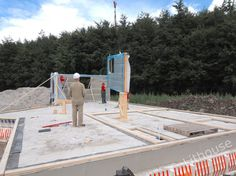 Installing panels on the foundation. Prefab Homes, Foundation, Construction, House, Prefab Cottages, Building, Prefabricated Houses, Home, Prefab Log Homes