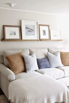 the picket fence projects: Family room follow-up & our DIY picture ledge.........love this idea for above the couch