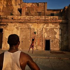 Photo by @dguttenfelder | A man and and boy play basketball in front of their home on the Malecon in Havana Cuba. This area is one of the most popular for tourists looking for classic cars and the beauty of crumbling architecture along the sea but is also home to some of the most valuable real estate in Havana. For the next week we will be traveling aboard the first U.S. Cruise to Cuba in nearly 40 years. by natgeo
