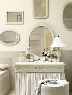 White mirrors grouped on a wall