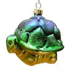 "Turtle Christmas Ornament from Varsovia of Poland  Approximately 4"" x 4"" Bluish green color with gold glitter details.  Each exquisite piece is mouth blown and hand decorated by"