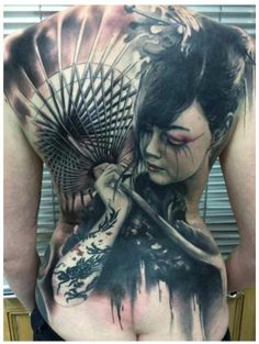 This stunning realistic geisha tattoo with her sunshade was made by Florian Karg (Germany).