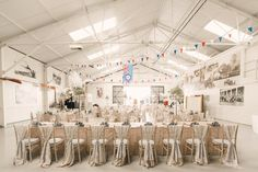 Hangar 3 at the Shuttleworth Collection was the perfect setting for Steve & Georgina's 1920s wedding. They chose chiavari chairs, sequin table cloths and ostrich feather and pearl string centrepieces, and patriotic bunting. 1920s Wedding at Swiss Gardens Shuttleworth and Aircraft Hangar 3