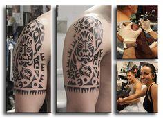 Полинезийская татуировка  на плече у парня