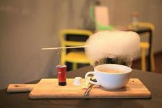 A cup of coffee with a sugar cloud right on the top, while heat is coming up, then sugar cloud will melt to liquid type just drop into your coffee. ~Tingiun
