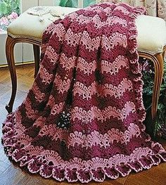 "Lacy Scallops Afghan Crochet ePattern - Number of Designs: 1 afghanApproximate Design Size: 49"" x 72""Designer: Terry Kimbrough Original Publication: Leisure Arts Leaflet #1292, Victorian Beauties †Description: An overall lace pattern and a ruffled edging add femininity to the bold scallops of this nostalgic wrap. The afghan is crocheted using worsted weight yarn and a size H (5.00 mm) hook. †Product Type: Digital Download ThemesAfghans"
