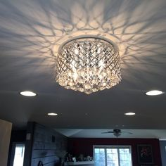 Delanie Flush Mount Crafted from metal in a gleaming chrome finish, this sleek and chic four Moroccan Ceiling Light, Crystal Light Fixture, Chandelier Style, Bathroom Light Fixtures, Bathroom Ceiling Light, Solar Light Crafts, Light, Living Room Lighting, Chandelier