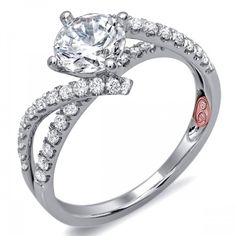 DemarcoJewelry.com  Available in White Gold 18KT and Platinum. 0.45 RD Capture her grace and endless beauty with this confident yet elegant design. We have also incorporated a unique pink diamond with every single one of our rings, symbolizing that hidden, unspoken emotion and feeling one carries in their heart about their significant other. This is not just another ring, this is a heirloom piece of jewelry.   Demarco Bridal Engagement Ring.