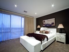 Modern bedroom design idea with carpet & floor-to-ceiling windows using beige colours - Bedroom photo 139873