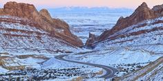 The Interstate 70, which runs through Utah, is most beautiful in winter, especially when it winds its way through the snow-covered Spotted Wolf Canyon.