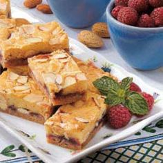 Raspberry White Chocolate Bars ~ The attractive look of the bars or their incredible aroma while they're baking ~ which is more appealing!!  ! Everyone who tries these asks for the recipe.