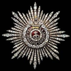 Order of St. Catherine star, instituted on 24 November 1714 by Tsar Peter the Great on the occasion of his marriage to Catherine I of Russia.  For the majority of the time of Imperial Russia, it was the only award for ladies.   Awarded to ladies, in 2 classes - the Greater and the Lesser Cross star.  This is a close up view of the front side of the Greater Cross star of the Order.