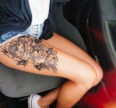flowers thigh tattoo 65