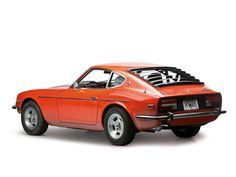 "1973 Datsun 240Z - I had one of these, too...in red. It was VW ""Iberian red"" - an absolutely gorgeous shade of red. This car was a serious looker. Why did I sell it? I sold it to buy a Yamaha Virago motorcycle - what a horrible mistake."