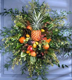 Traditional Fruit Swag ~ Create a traditional look for your home with this door swag of greenery and fruit. This style can be fashioned from real or artificial branches and fruits, though the artificial variety will last longer and is easier to make.