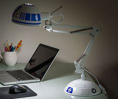 This architectural style desk lamp is made to look just like from Star Wars, except, you know, in lamp form. Officially licensed from Star Wars and sold by ThinkGeek this desk lamp is sure. Lampe Star Wars, Star Wars Lamp, Star Wars Decor, Objet Star Wars, Anglepoise Lamp, Star Wars Bedroom, Best Desk Lamp, Kid Desk, Star Wars Gifts