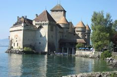 Chillon Castle - Veytaux, Switzerland--- Perched on the shored of Lake Meman, this castle was the subject of a famous poem by Lord Byron, the Prisoner of Chillion.The 17th century poet even carved his name into a pillar in the castles dungeon.